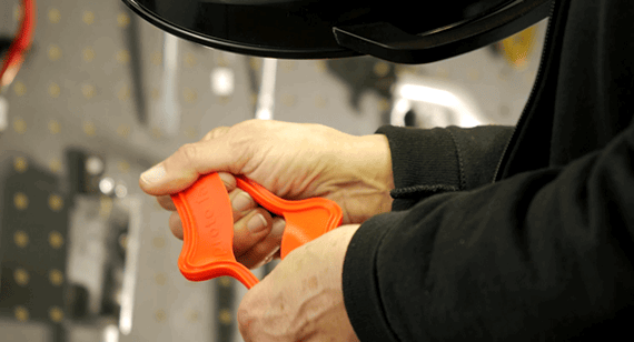 engineer stretches liquid injection moulded part